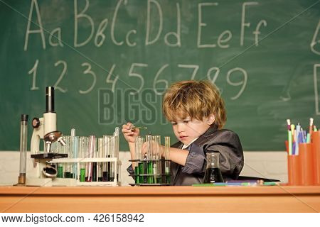 Educational Experiment. Boy Microscope And Test Tubes School Classroom. Knowledge Concept. Fascinati