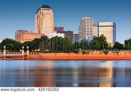 Shreveport, Louisiana, USA downtown skyline on the Red River at twilight.