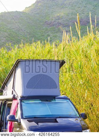 Camper Van With Roof Top Tent Camping On Mediterranean Coast. Holidays And Travel In Mobile Home.