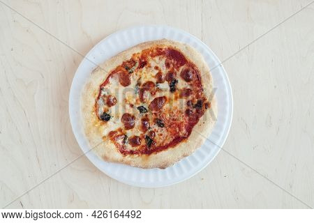 A Close-up Of A Mini Pizza In A Disposable Dish. Top View Of Takeaway Food In Fast Food Cafe. The Ph