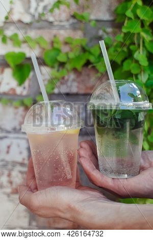 Close-up Of A Glass With Lemonade Or Mojito Cocktail. Summer Drink With Ice, Juice And Soda. Cooling