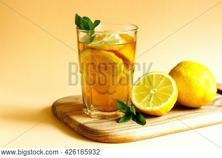 Refreshing Iced Tea Out Of Black Tea, Lemon Slices, Garnished With Fresh Mint Leaves