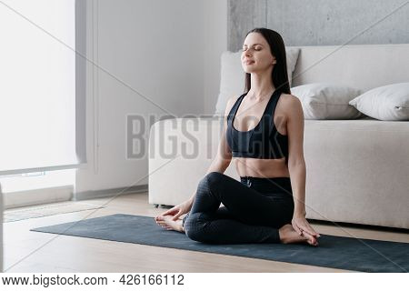 Beautiful Relaxed Woman In Knee Pile Position While Practicing Yoga On Spots Mat At Home, Closing He