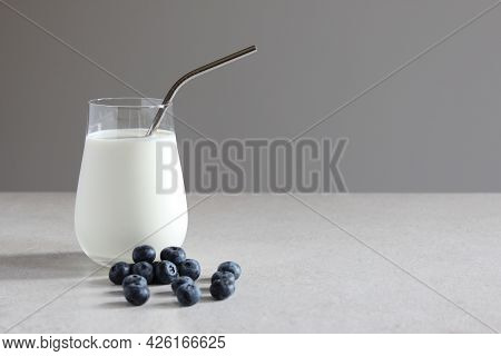Milk An Blueberries On The Table. Vegan Or Vegetarian Milk. Vegetables Milk. Healthy Food Concept. A