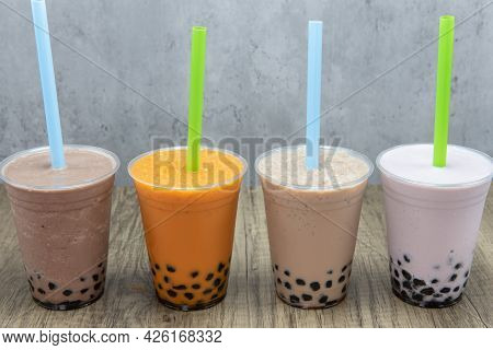 Various Colors And Flavored Smoothies With Sweet Tapioca Boba Balls At The Bottom Of The Cup For Fla