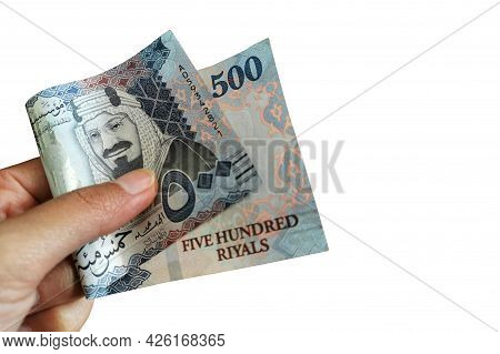 500 Saudi Riyal Banknote In Hand Isolated On White Background. Copy Space Is On The Right Side.