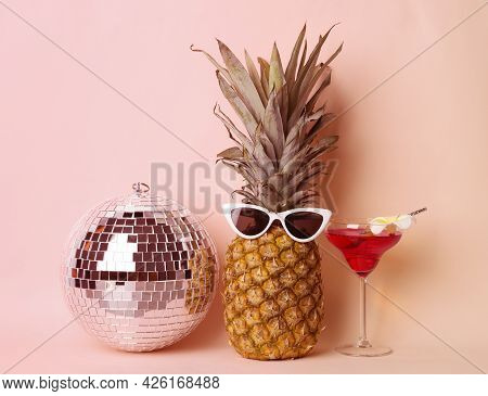 Funny Pineapple With Sunglasses, Cocktail And Disco Ball On Pink Background. Summer Party