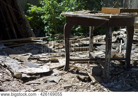 Discarded Vintage Table Abandoned Outside A Ruined House