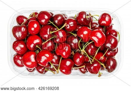 Fresh Cherries In A Plastic Container. Ready To Eat, Red And Ripe Fruits Of The True Cherry Species
