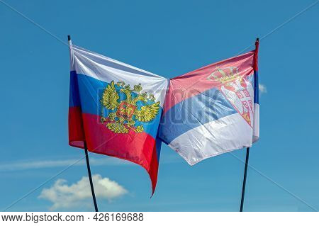 Russian And Serbian Flags Together Symbol At Blue Sky