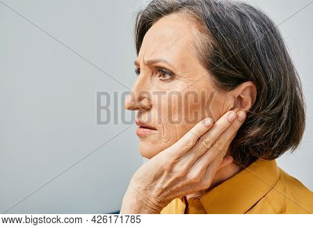 Hearing Loss. Mature Woman With Hearing Problems Touching Ear With Hand. Side View, Earache