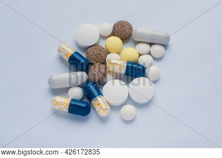 Tablets And Pills On The White Table, Consuming A Lot Of Pills Concept