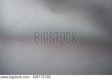 Close-up of the fabric of a waterproof mountain backpack.