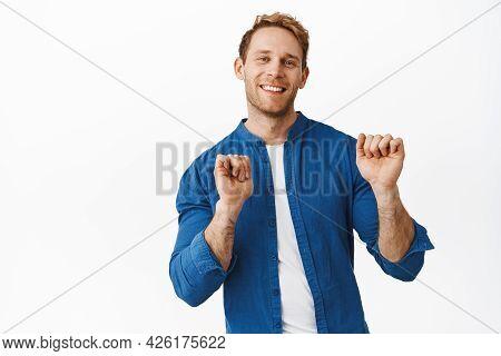 Happy Handsome Redhead Man Smiling, Looking At Camera Joyful And Dancing, Raising Hands Up, Moving C