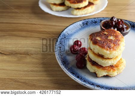 Three Pancake Cheesecakes Lie A Stack Of Slides On Top Of Each Other On A Plate On A Table With Cher