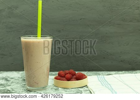 Delicious And Cold Milkshake With Fresh Raspberries. Fresh Raspberry Smoothie. Background With Copy