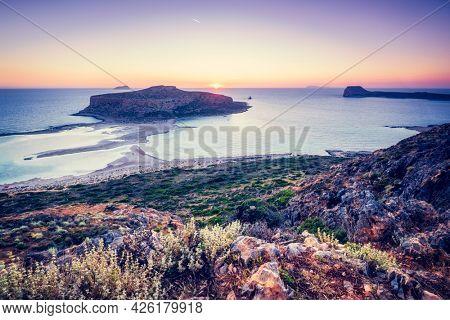 Island Gramvousa and the beautiful Balos beach on sunset in Crete island, Greece. Horizontal camera pan