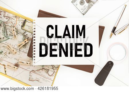 Claim Denied. Text On Notepad On White Background