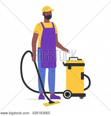 Young Worker Of Cleaning Service. A Man Dressed In A Uniform With A Vacuum Cleaner. Guy Hoover Up Fl