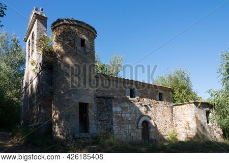 Beautiful View Of A Church With A Stone Round Tower At Merindades, Burgos, Spain. Blue Sky. Europe