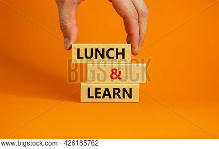 Lunch And Learn Symbol. Wooden Blocks With Concept Words Lunch And Learn. Beautiful Orange Backgroun