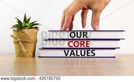 Our Core Values Symbol. Books With Words 'our Core Values'. Beautiful Wooden Table, White Background