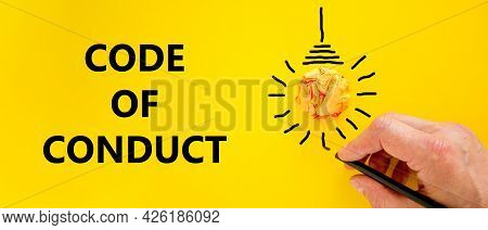 Code Of Conduct Symbol. Businessman Writing Words 'code Of Conduct', Isolated On Beautiful Yellow Ba