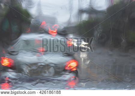 Abstrack And Blur Images Of Cars Driving On The Road While Raining, To Transportation And Rainy Seas