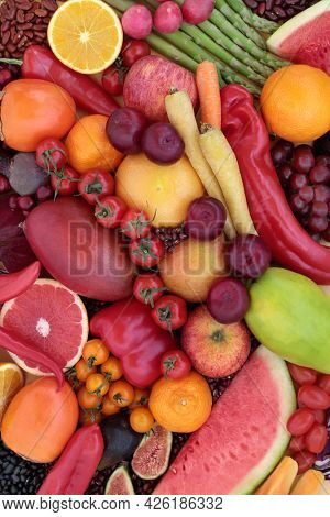 High in lycopene fresh fruit and vegetable collection for good health with immune boosting superfoods also high in anthocyanins antioxidants, dietary fibre, vitamins. Healthy eating concept. Flat lay.