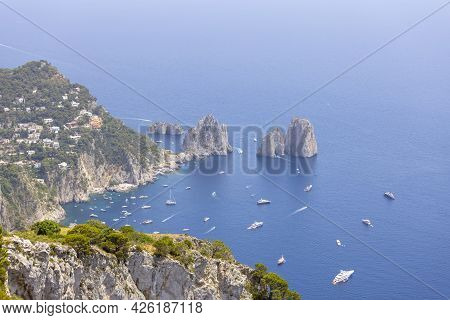 Faraglioni, Attractive Coastal Rock Formation Eroded By Waves, Located Off The Coast Of The Island O