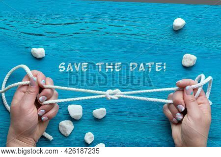 Text Save The Date. Summer Nautical Abstract Grungy Background With White Stones, Hands With Sailors