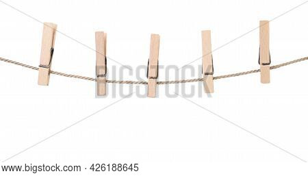 Clothespins On A Rope Close-up On A White Background. Isolated