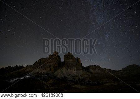 Tre Cime di Lavaredo at night in the Dolomites, Italy