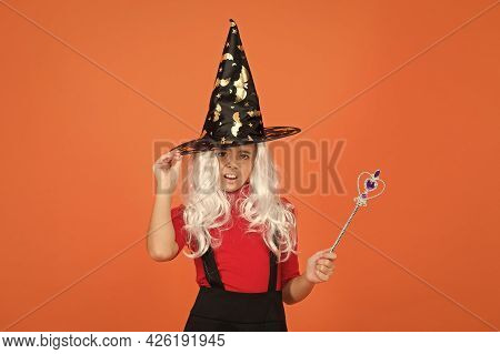 Happy Halloween. Smiling Child In Witch Hat. Kid Hold Magic Wand. Childhood Happiness. Teen Girl Rea
