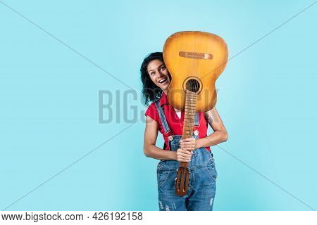 Happy Pretty Woman With Brunette Hair Play Acoustic Guitar, Vocal