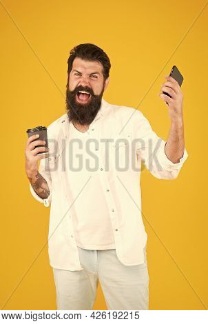 Angry Businessman With Coffee Using Mobile Phone And Shouting Emotionally, Negative Human Emotions