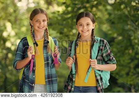 Smart Girls. Childhood Hapiness. Two Sisters In School Uniform Outdoor. Ready For Holidays. Happy Te