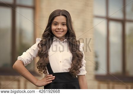 New School Year. Happy School Girl Outdoors. Little Girl Back To School. Fashion Uniform For Girls.