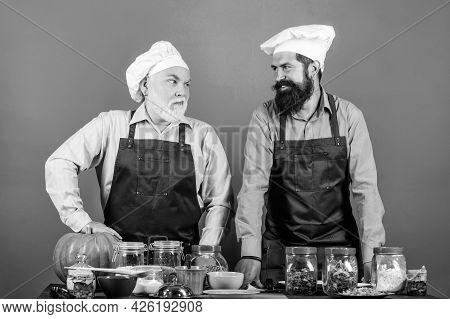 Family Restaurant. Mature Bearded Men Professional Restaurant Cooks. Chef Men Cooking. Prepare Food.