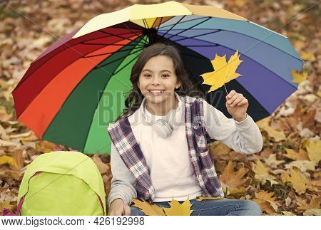 Perfect Autumn Day Of Cheerful Girl Under Colorful Umbrella With School Bag Sitting In Fall Season P
