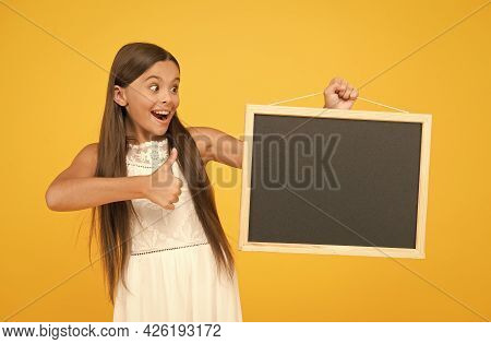 Small Kid With Blank Blackboard. Advertisement Promotion Copy Space. Good News For You. Chalkboard F