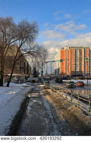 Balashikha, Russia - March 19, 2021. Residential Neighborhood In The Spring. Snow Melting On The Str