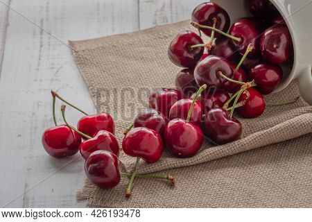Berries Of Ripe Red Sweet Cherries Scattered On A Wooden Background, Healthy Natural Food, Vitamins