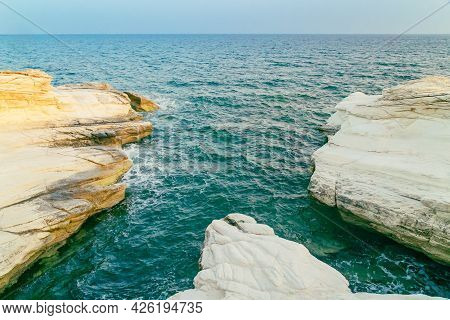 White Stones Or Rocks Beach On Cyprus. A View Of A Sea Shore. White Rocks And Stone Coast