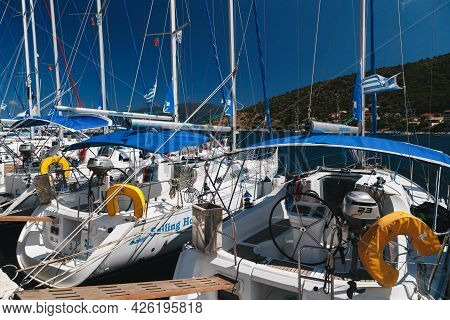 Agia Efimia, Cephalonia Island, Greece - July, 14 2019: Close Up Of White Yachts For Rent Against Bl