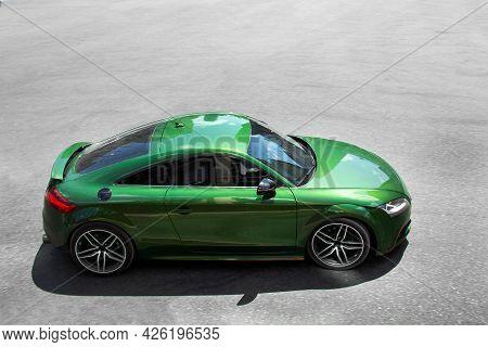 Kiev, Ukraine - June 19, 2021: Fast German Green Car Audi Tt In Motion. Blurred Car