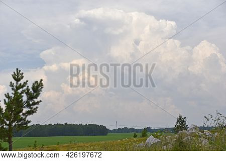 Thunderstorm Landscape And Cumulus Clouds In The Field
