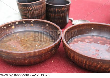 Lentils And Beans Soaked In Water In A Wooden Dish For Cooking