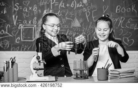 Little Girls Scientist Work With Microscope. Little Girls In School Lab. Science Is Future. Biology
