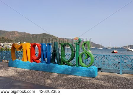 Marmaris, Turkey - July 2021: Inscription Marmaris On The Town Embankment. View Of The Harbour With